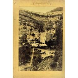 2 FOTOS: ST. MIQUEL DEL FAY (A) -VISTA GENERAL(B). Ph. J. YLLA
